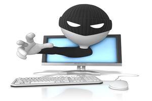 詐欺師とパソコンのイラスト